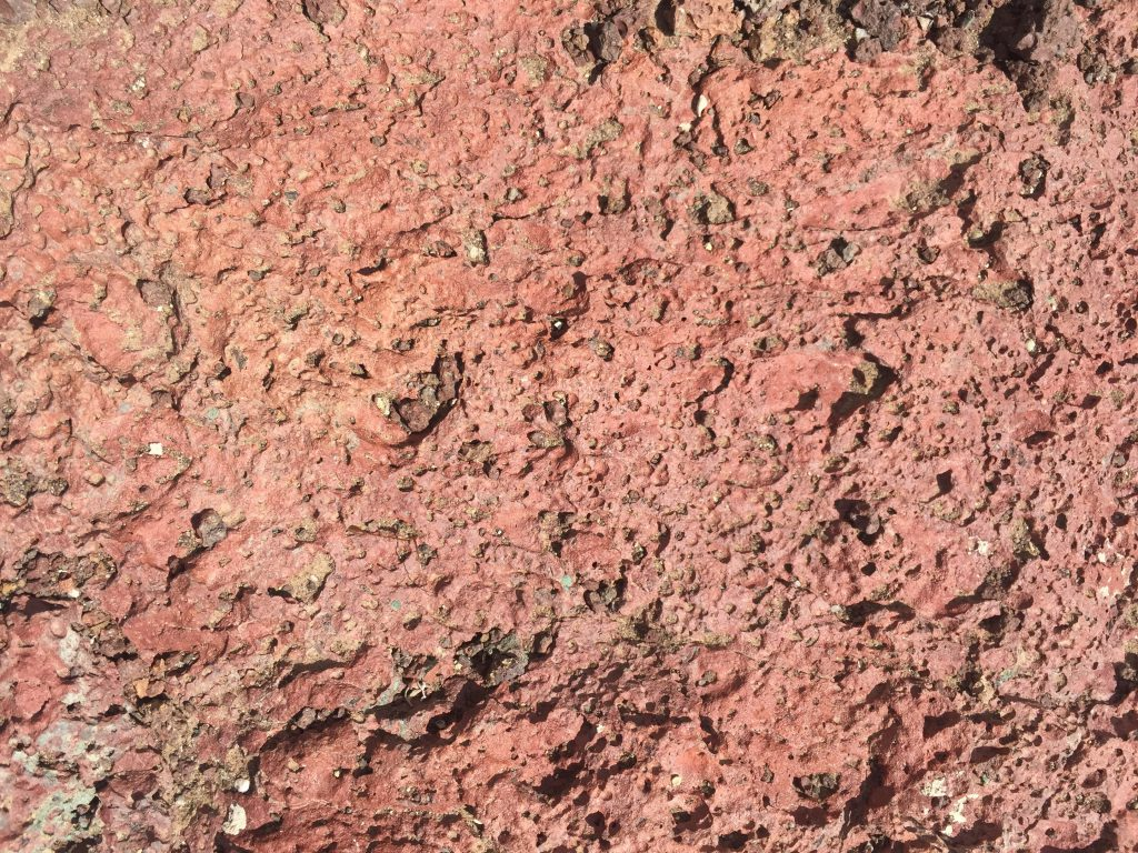 Flakey red rock with layers of texture and bumps