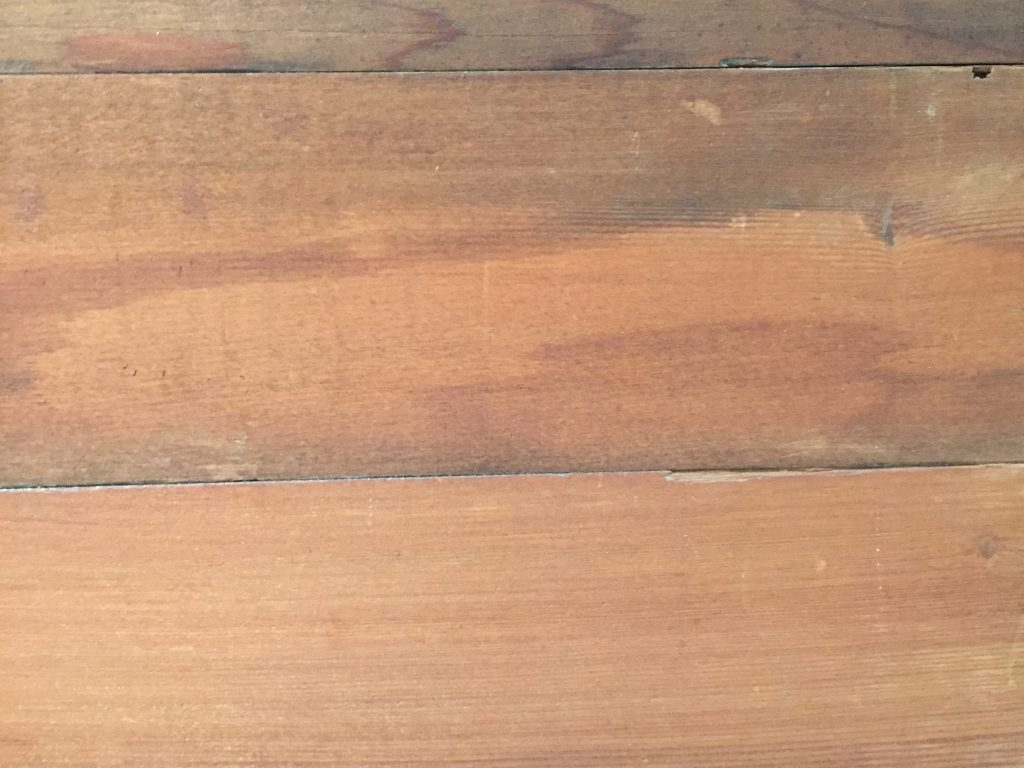 Rich brown stain on wood planks