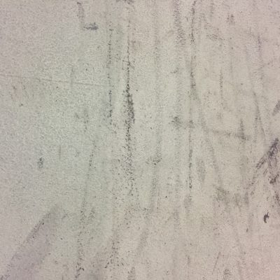 Dirty white surface with black scuffs