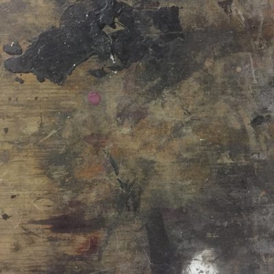 Detailed shot of old wood table covered in paint, mainly black