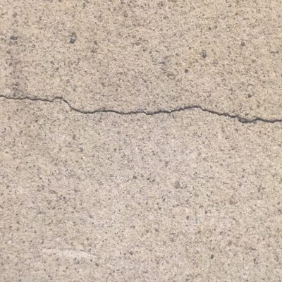 Composite concrete wall with cracks