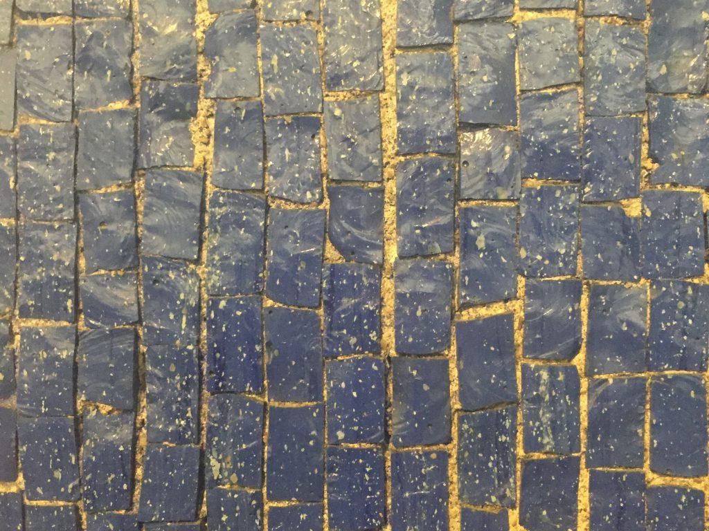 Uneven tiles featuring dark blue color