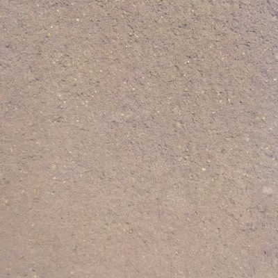 Medium brown coarse texture with specs