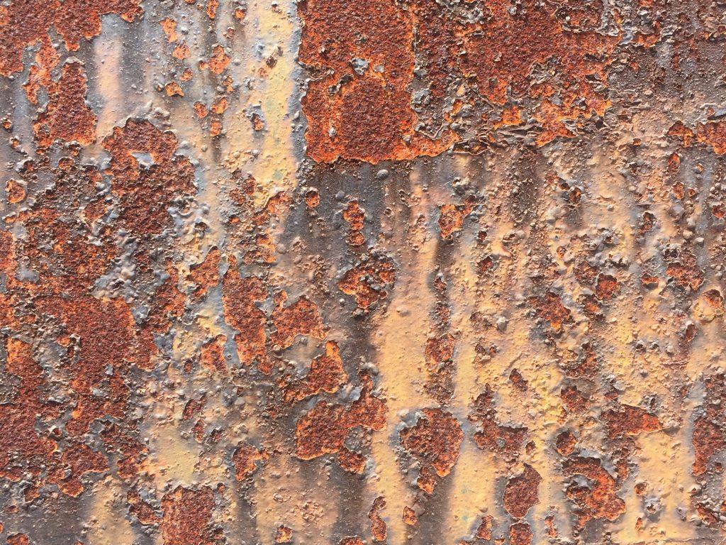 Deep rust under chipping paint texture