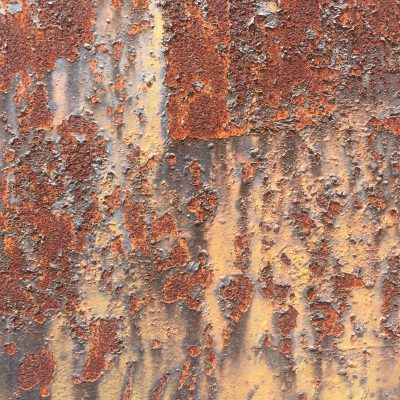 Deep rust under chipping paint texture