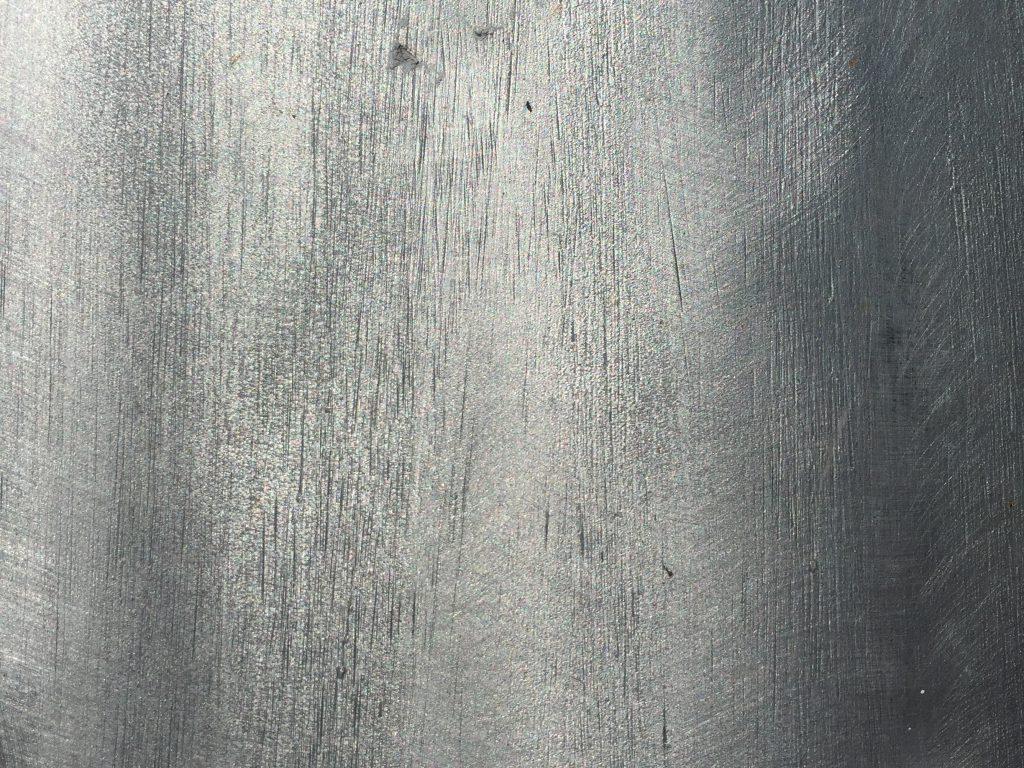 Shiny metallic paint over wood