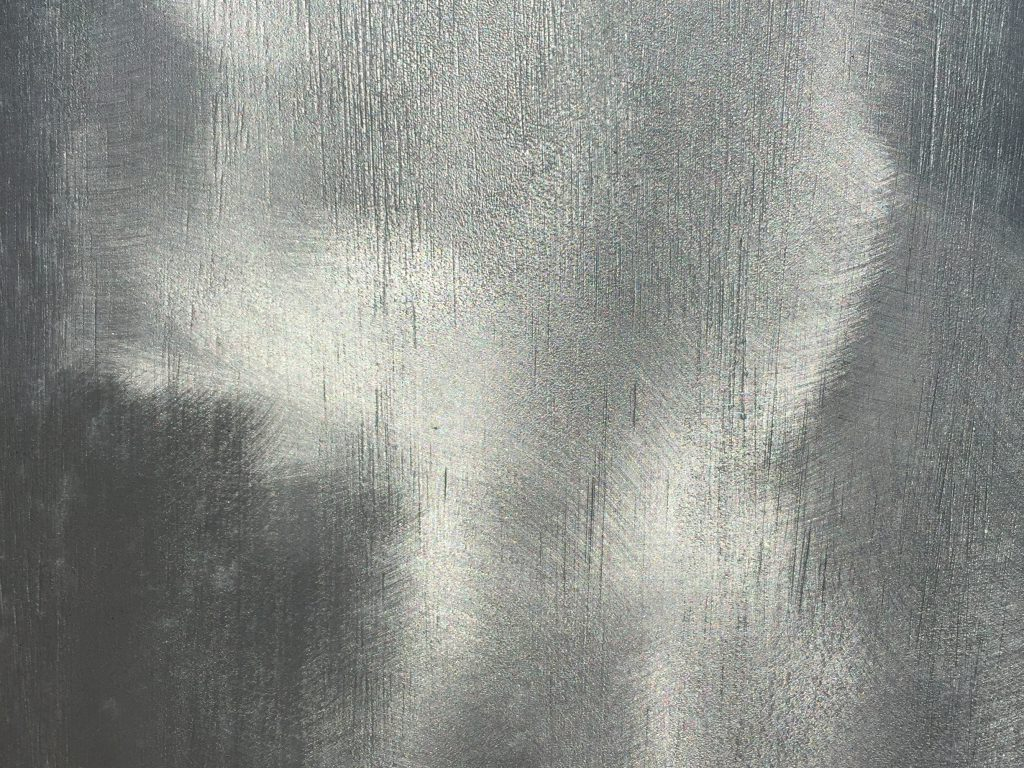 Layered paint strokes featuring grey to bright silver color
