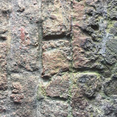 Old beat up brick path close up