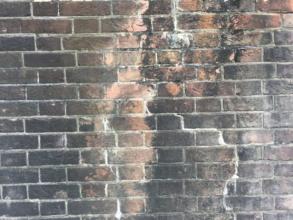 Cracked and dirty brick wall
