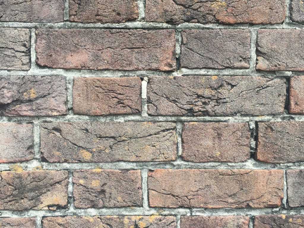 Brick wall with lots of cracks