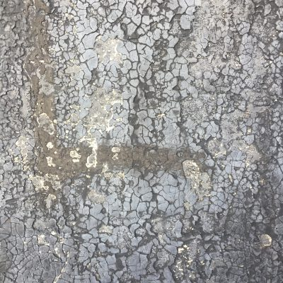 Dried out and cracking tar on concrete