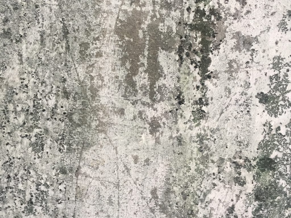 Concrete wall filled with scratches and layers of texture