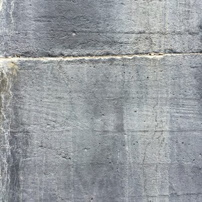 Medium grey concrete wall with streaks