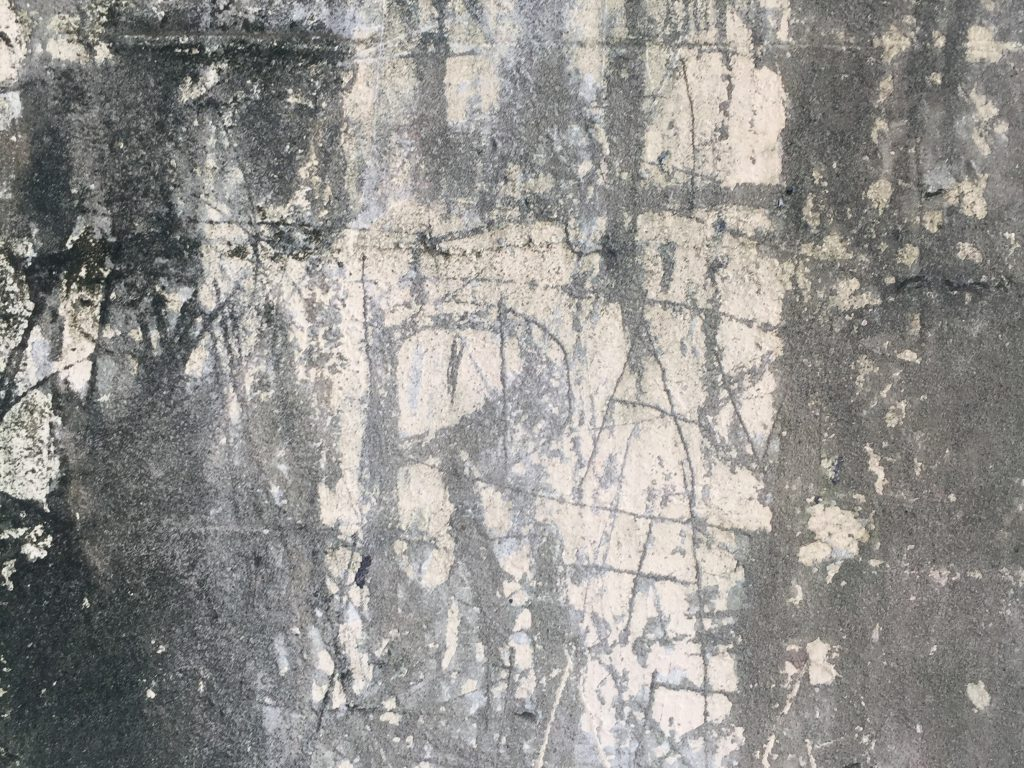 Dark wall with tons of grunge and white marks