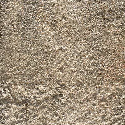 Off white stucco that has very coarse texture