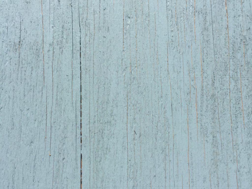 Light blue painted wood panel