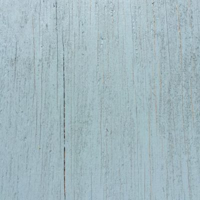 Light blue painted wood panel