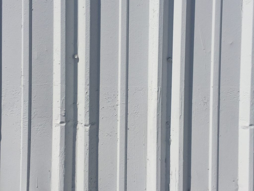 Dented metal wall