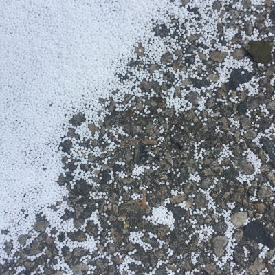Tiny white balls over concrete