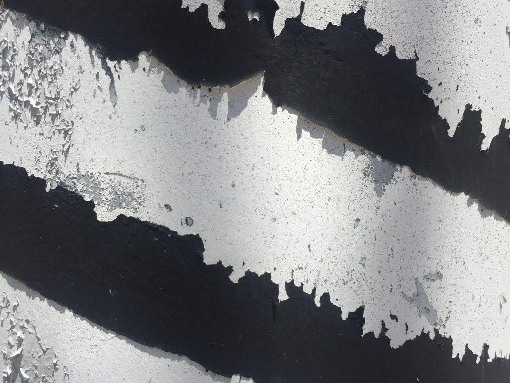 Diagonal black and white paint