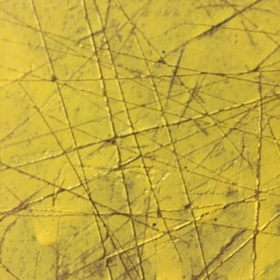 Yellow acrylic paint with score marks