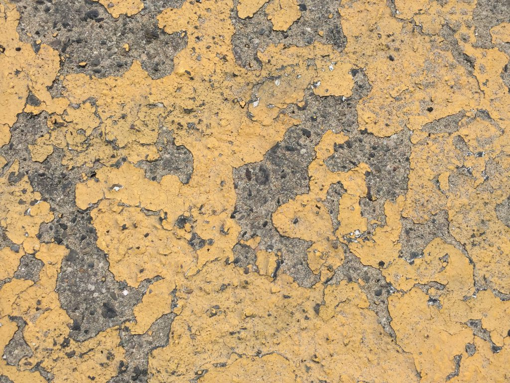 Orange yellow melted paint on concrete