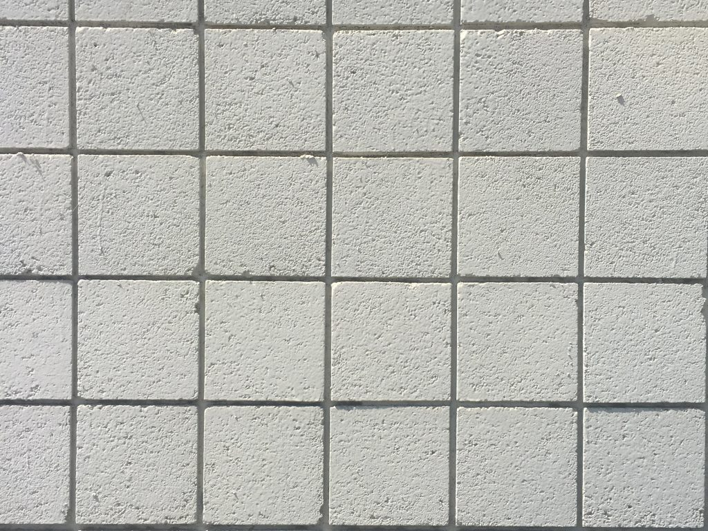 Concrete wall with grid of squares
