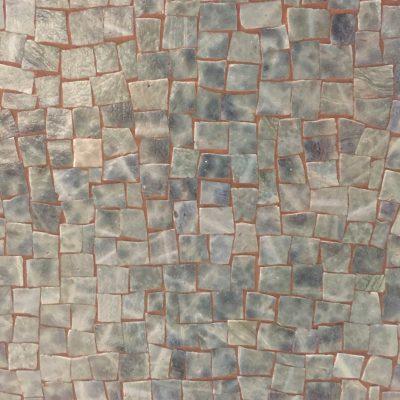 Hand cut tiles in mosaic