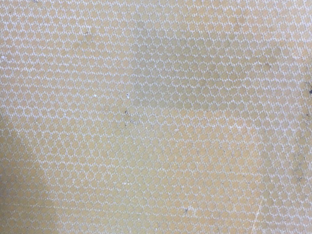 Hard plastic base with white honeycomb pattern