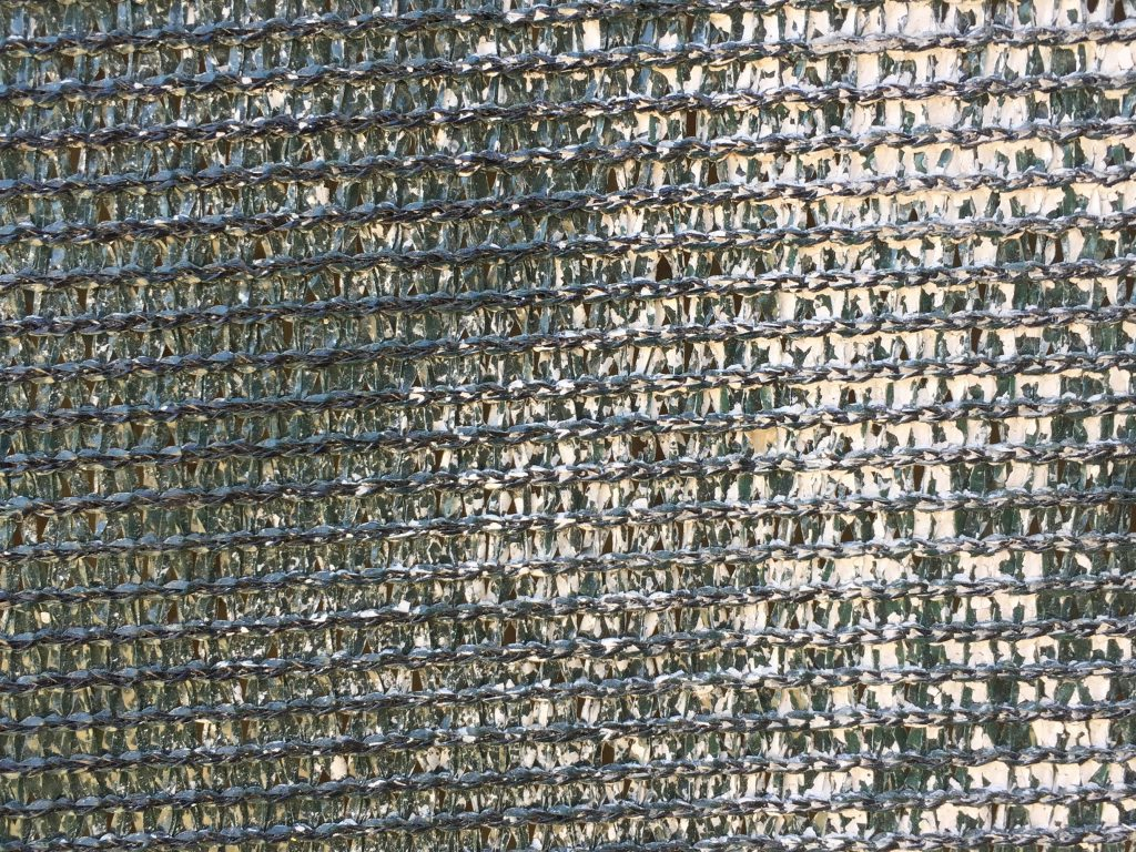 Dark green plastic woven fence fabric