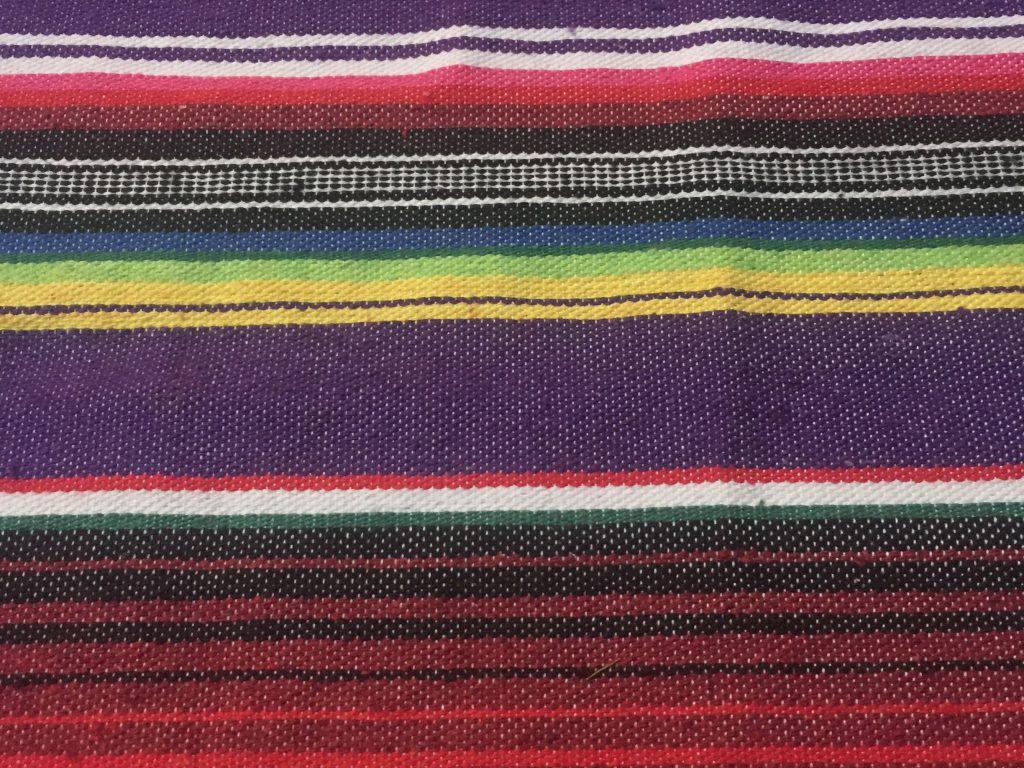 Rainbow bars of color on fabric