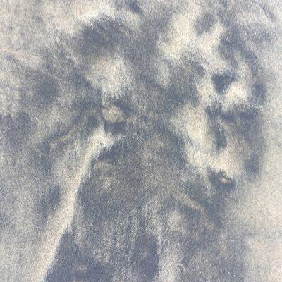 Black blotchy sand over tan base