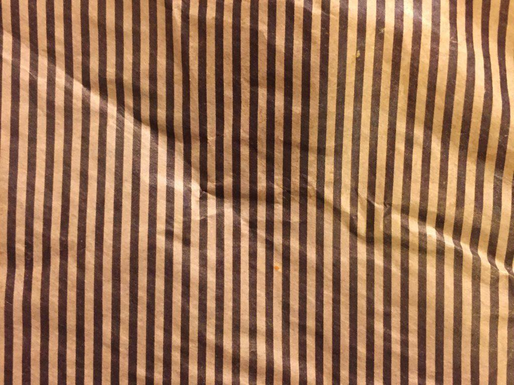 Dark brown printed stripes on paper