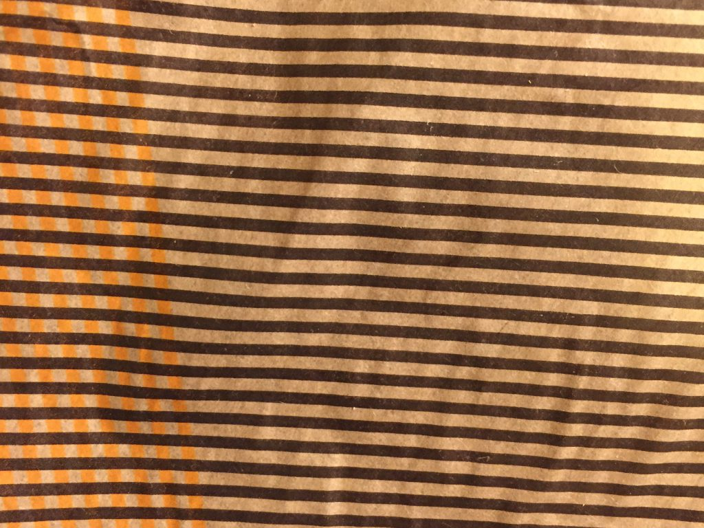 Dark brown and orange bars printed on paper