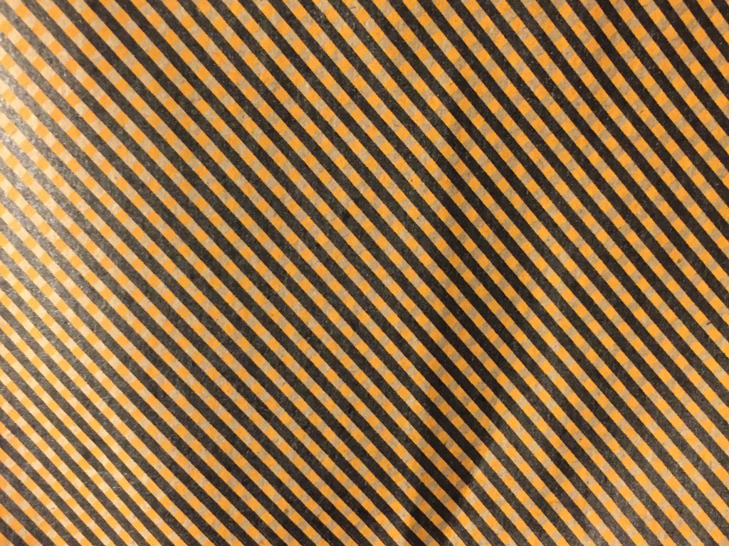 bent paper with printed stripes