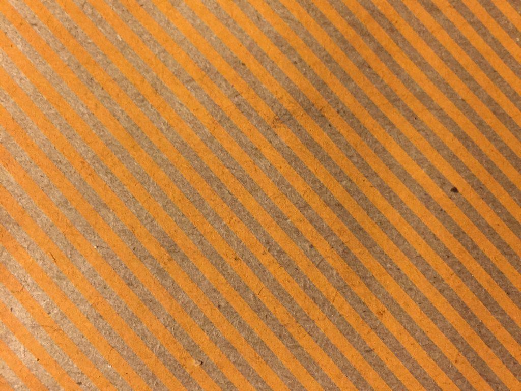Orange printed stripes on paper