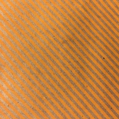 Orange printed stripes on paper