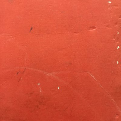 Red beat up paper