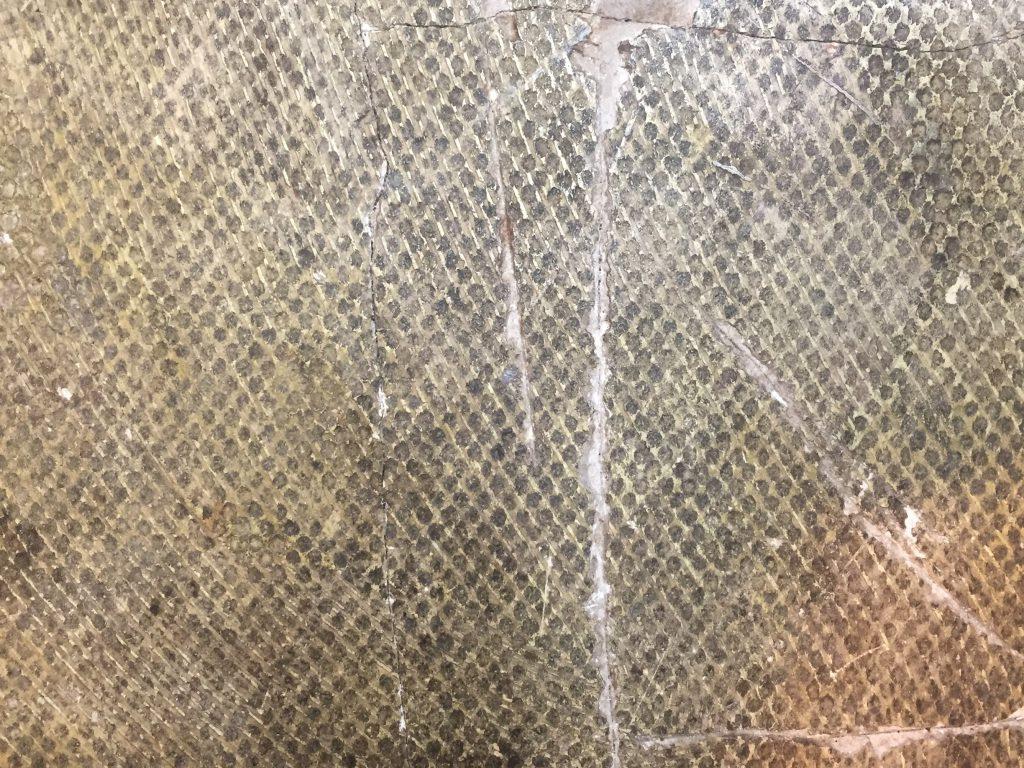 Grungy grey glue on concrete