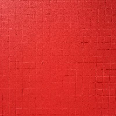 Vivid red paint on concrete wall