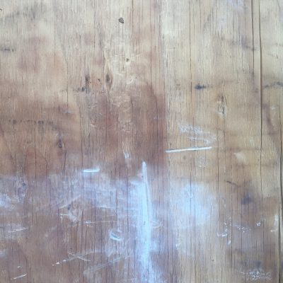 Plywood with cracks and white paint