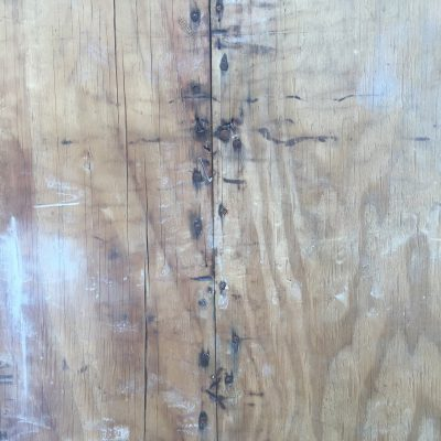 Old plywood with rusty nails
