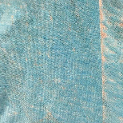 Discolored and weathered old blue cloth