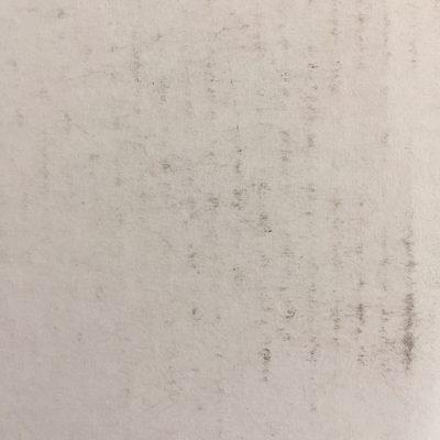 Off-white paper with black scuffs