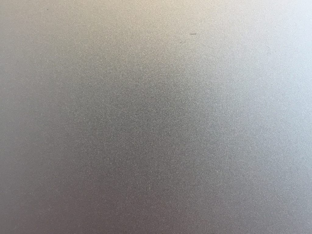 Gradient of silver to light orange plastic