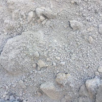 Clumps of gray dirt covering rocks
