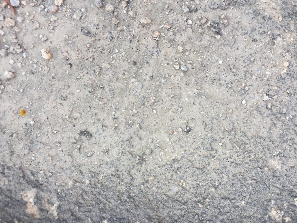 Rocky surface with dirt and loose rocks