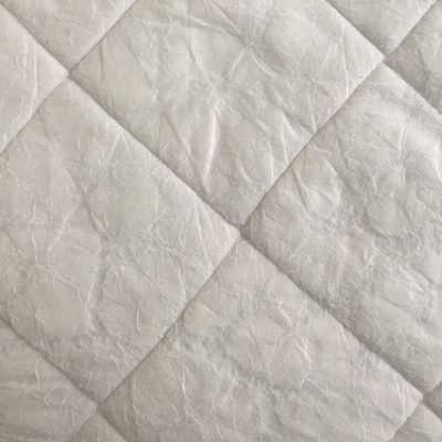 Diamond pattern in white cloth padding