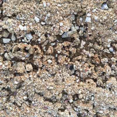 Clumps of sandy dirt with gravel mixed in