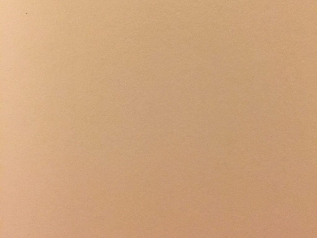Tan and pink paper close up